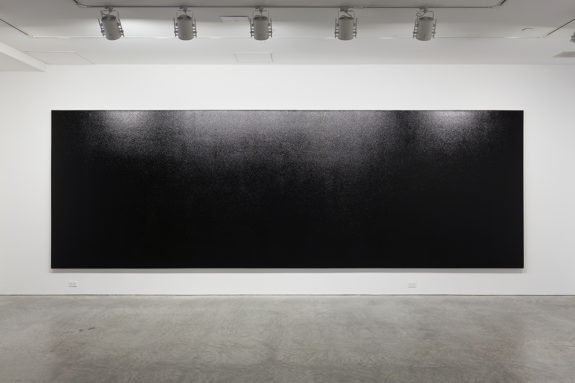large black painting a gallery