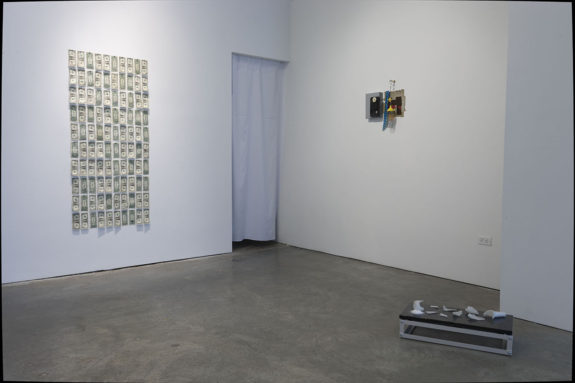 wall pieces and sculptures in a gallery