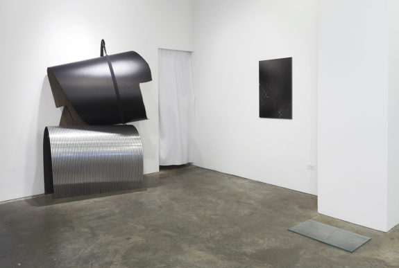 painting and a large sculpture in a gallery