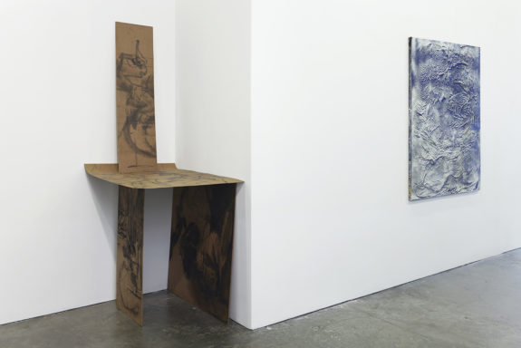 painting and a sculpture in a gallery