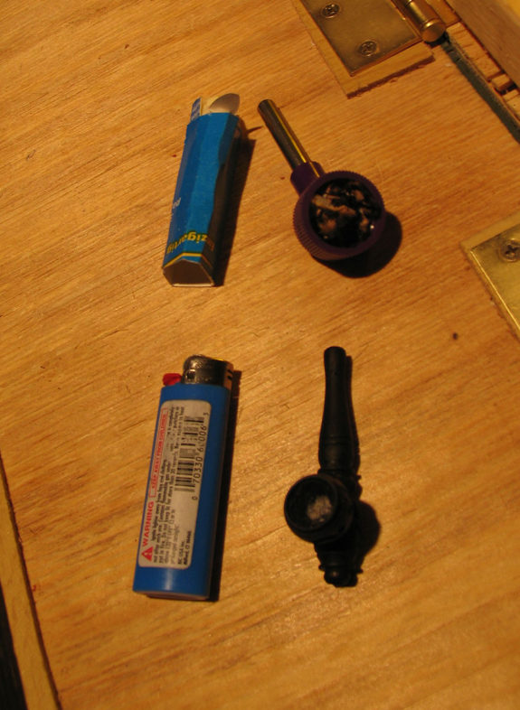 Lighter and pipe on table
