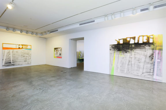 paintings in a gallery